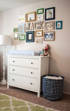 So cute! Love the neutral walls and furniture and how all the color is in the frames and decor#nursery