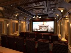 The pinnacle of class and elegance, this home theater was designed to resemble a 1920s movie palace, complete with 12 plush chairs with custom-patterned fabric, a chandelier and wall sconces to add warmth. The space also features a coffered ceiling treatment with custom moldings and an embossed copper ceiling. Photo courtesy of Elite Home Theater Seating