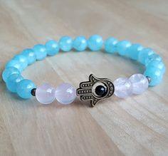 Check out this item in my Etsy shop https://www.etsy.com/listing/293746231/hand-hamsa-aquamarine-amethyst-bracelet