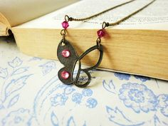 Antique half hollow butterfly charm with pink by LittleApples