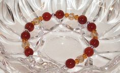 Bracelet red amber Swarovsky Crystals. Hand Made in by Momentidoro, €36.00