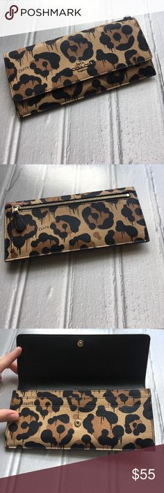 Coach Soft Wallet in wild beast print leather This classic Coach soft wallet in sturdy but supple pebble leather has a fun edge with the wild beast print that is inspired by street art in Los Angeles. Gary Baseman, an artist out of LA, is the designer of this print as well as the wacky cartoons Coach has been playing with for the past few years. A new twist on animal print, this is a classic piece you can pair with just about everything if you're bold enough. Unused. Coach Bags Wallets