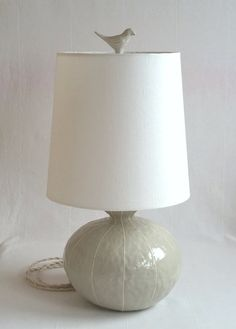 Ceramic lamp. Medium size, round gourd shape table lamp. Modern handmade base with linen shade topped with small bird finial. OOAK