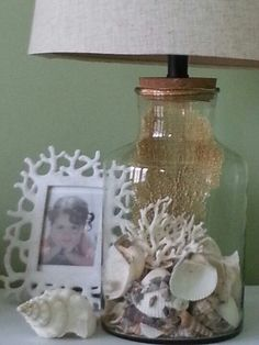 Fillable glass lamp from Home Goods store. I'm going to put mixed gold bronze silver marbles to tie in furniture in bedroom. Home Goods Store, Home Goods Decor, Seaside Decor, Coastal Decor, Coastal Living, Nautical Picture Frames, Fillable Lamp, Handmade Lamps, Shell Crafts