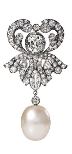 PEARL AND DIAMOND BROOCH. Stylized leaves, set with old cut diamonds, a cushion and a marquise, holding a baroque pearl measuring approximately 15.27-15.49 x 18.06 mm. mounted in silver, 9K gold, late 19th century