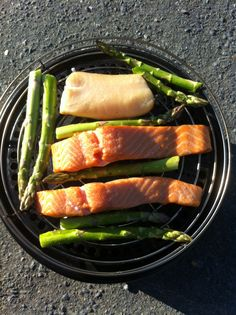 Hot smoked Salmon, Hake and Asparagus, cooked on Ramsay beach in the Cobb bbq. I added a handfull of damp oak chips on to the cobblestone. Ready in 20 minutes and tasted amazing with a salad, a glass of Alsace my lovely hubby and Hummock my beautiful black Lab! I know how to live