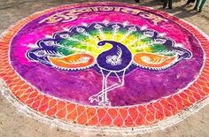 Peacock rangoli design got prime attention in all types of festivals. Here are the 25 best Peacock Rangoli Designs for all occasions, and these looks are very vibrant and colorful. Indian Rangoli Designs, Rangoli Designs Latest, Colorful Rangoli Designs, Mehndi Designs, Peacock Rangoli, Diwali Rangoli, Beautiful Mehndi Design, Colored Sand, Simple Rangoli
