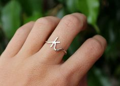 Customize your own ring with your initial. This ring has been made entirely by hand. The letter has been hand formed with sterling silver,