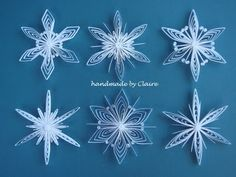 beautiful quilled snowflakes by Claire Sun-Ok Choi! instructions (in Korean, but with photos) here: http://clairespapercraft.blogspot.com/2010/11/how-to-make-snowflake-tutorial.html
