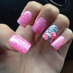 Glittery pink nails with a bow