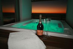 Chilled champagne + warm jacuzzi + blazing sunset = The perfect way to spend an evening with your other half. Penthouse Apartment, Bath Caddy, Jacuzzi, Chill, Champagne, Camping, Romantic, Warm, Sunset