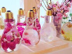 Enchanting Flowers Suspended in Light Bulbs Glisten Like Precious Jewels