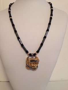A personal favorite from my Etsy shop https://www.etsy.com/listing/199940906/biker-necklace