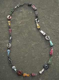 ButtonArtMuseum.com - 'distressed' vintage button and zipper slide necklace :: © amalia versaci 2010 by Amalia Versaci