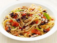 Linguine with Tuna Puttanesca : A classic puttanesca sauce made with tomatoes, olives and capers gets a hit of lean protein with the addition of oil-packed tuna.