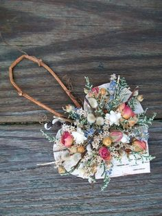 Beautiful Heart Shaped Birch Bark Ornament Wall Hanging with Ammobium Dried Roses Lavender and Pussy Willows. $12.50, via Etsy.