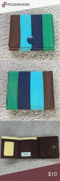 American Eagle Striped Wallet American Eagle striped wallet with a magnetic front clasp. On the inside there is a coin pouch, ID slot, and five card slots. American Eagle Outfitters Bags Wallets