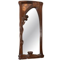 Early 20th century Art Nouveau mirror attributed to Jacques Grüber, framed in walnut with a marquetry decor at upper left corner.