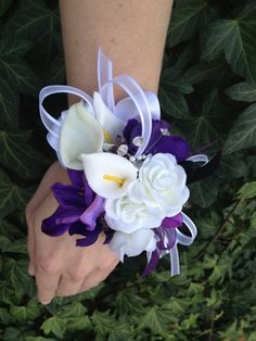 Purple and white wrist corsage for mothers of the bride and groom