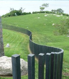 curved fence winding through the landscape. Pinned to Garden Design - Walls, Fences & Screens by Darin Bradbury.Contemporary curved fence winding through the landscape. Pinned to Garden Design - Walls, Fences & Screens by Darin Bradbury. Modern Landscape Design, Modern Landscaping, Contemporary Landscape, Landscape Architecture, Garden Landscaping, Modern Design, Landscaping Tips, Garden Types, Garden Screening