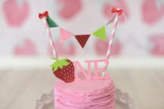 I+am+so+excited+you+are+here+and+I+would+love+to+tell+you+a+bit+more+about+this+Strawberry+Cake+Topper!+When+selecting+the+SET+you+will+receive+the+banner+and+topper.+If+you'd+like+a+different+age+please+shoot+me+a+message!+All+my+toppers+are+made+of+glittered+card+stock;+Fairies+sprinkle+it+with...