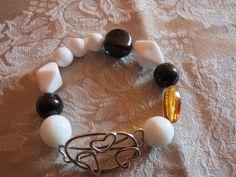 armbånd lavet af glasperle og sølv