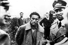 WWII. Yasha Dzhugashvili (center), Stalin's son from his first marriage, is seen here after he surrendered to the Germans in 1941. Recently released Russian documents suggest that Yasha was written off by his father because of his surrender. Yasha later committed suicide by falling on the electrified fence of the Sachsenhausen  concentration camp in April 1943.