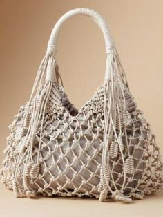 STRING ALONG BAG -- Getting entangled can turn beautiful—with an artfully knotted boho bag full of free-spirited, worldly charm. Sturdy cotton/polyester lined.DIY Macrame Bag Ideas: You just don't tell me you still haven't heard of macramé stuff… Macrame Design, Macrame Art, Macrame Knots, Diy Bags Hanger, Macrame Purse, Collar Macrame, Crochet Purses, Crochet Bags, Micro Macramé