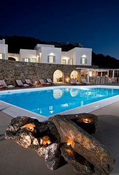 Stone wall, pool. PINO DI LOTO Luxury Apartments, Syros island- Greece. Stone Greece Architecture, Facade Architecture, Beach Villa, Beach House, Syros Greece, Rooftop Terrace, House Exteriors, Exterior Lighting, Luxury Apartments