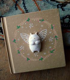 Un adorable carnet où griffonner petits mots et douces pensées...Mon Ange veillera sur chacun de vos petits secrets. Illustration réalisée à la peinture acrylique, tête d'an - 11432443