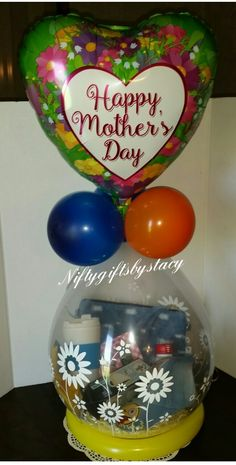#mothersdaygifts #mothersday #mom2be #stuffedballoon #giftinaballoon #balloongifts #giftbasket #balloons #gifts Wrapping Ideas, Gift Wrapping, Stuffed Balloons, Mothers Day Balloons, Balloon Gift, Stuffing, Gift Baskets, Chocolates, Christmas Bulbs