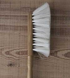 A medium sized dusting brush with soft goat hair bristles and a waxed beechwood handle. These brushes are particularly good for cleaning smooth items such as pianos and glass tables.