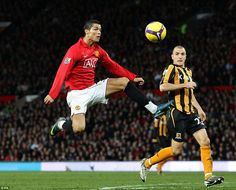 Manchester United's Cristiano Ronaldo controls the ball in mid air