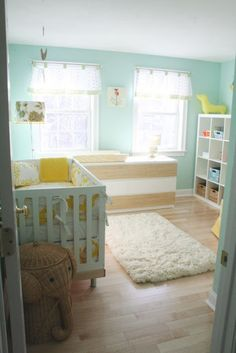 mint green/blue walls, precious decor and furniture combo nursery--and that elephant hamper would be perfection with a couple of Babar prints on the wall!