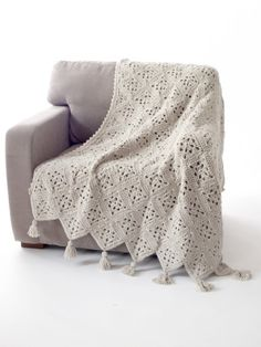 Just because your grannies are square doesn't mean you have to settle for a square blanket. A little creative placement and seaming creates this beautiful Diagonal Granny Afghan, crocheted with Vanna's Choice. A great heirloom or wedding gift, too!