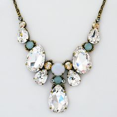 Sorrelli Riverstone. A glistening teardrop statement necklace, Wear separately or layer with other necklaces. Fab 4 bridal or evening wear.
