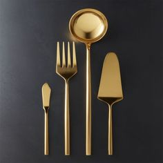Free Shipping. Shop 4-Piece Rush Gold Serving Utensil Set. Get a hold on gold at the table. Forged with substantial heft in 18/0 stainless steel with gold-colored finish. Matte finish handles contrast gleaming polished heads.