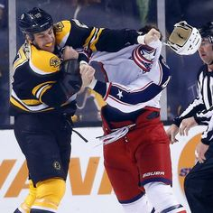 11/30/13 Milan Lucic knocks the helmet off Dalton Prout of the Columbus Blue Jackets during their 2nd period tussle at TD Garden.
