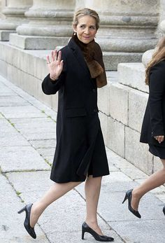 Infanta Elena of Spain arrived separately to her parents, wearing a black and brown ensemble, as she attends the mass for Count of Barcelona's 25th Anniversary's Death at the monastery of El Escorial