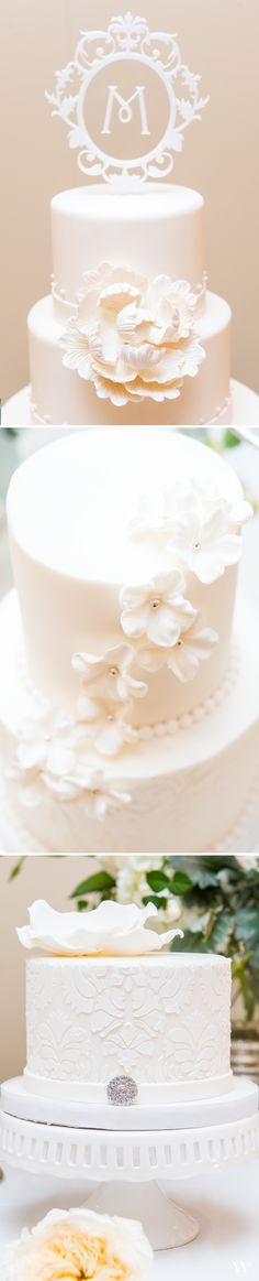A beautiful classic white wedding cake with an even more incredible floating monogram cake topper.