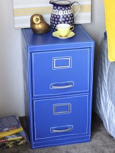 "spraypainted filecabinet... to look like blueprint! love it.  has full tute.  recommends "" Krylon's new Dual Paint, which is a spray paint and primer in one can. I picked my favorite color, True Blue (or as I affectionately call it, ""Ikea Blue"")"""