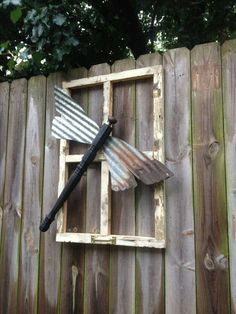 A most wonderful piece of dragonfly outdoor or indoor decor using old corrugated tin, old window and spindle!