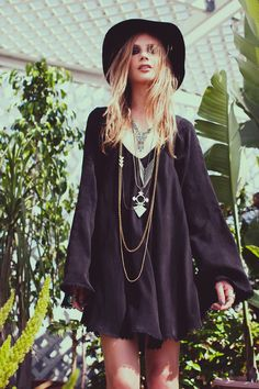 Over sized black boho dress. perfect for summer or winter! Simple but v cute with a hat and accessories.