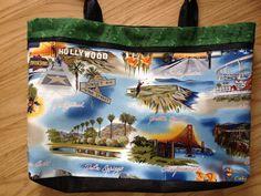 "Across the body sling bag. 21"" x 14"". California landmarks. Santa Monica, San Francisco, Pebble Beach, Palm Springs, Hollywood, San Diego, Universal Studios, California Cactus. Handmade tote. OC High School of the Arts OShop"