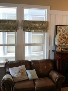 Tension rods and leftover fabric are used by Beth from Home Stories A to Z to make these faux Roman shades for her living room. The fabric is held into each pleat by the tension rods, making a simple, no-sew window treatment.