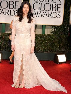 Jessica Biel on the red carpet in an ivory pearl Elie Saab dress (paired with Christian Louboutin heels) at the Golden Globes in Beverly Hills.
