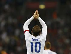 England captain Wayne Rooney celebrates after scoring his penalty during the international friendly soccer match against Norway at Wembley Stadium in London