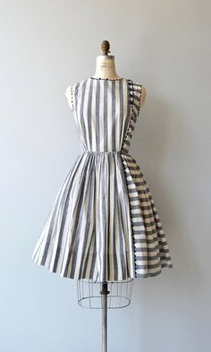 Vintage 1950s cotton dress with taupe and grey horizontal and vertical stripes, sleeveless bodice, button detail at one shoulder and upper back, fitted waist and metal back zipper. --- M E A S U R E M E N T S --- fits like: small bust: 36-38.5 waist: 26 hip: free length: 39 brand/maker: n/a condition: excellent to ensure a good fit, please read the sizing guide: http://www.etsy.com/shop/DearGolden/policy ✩ layaway is available for this item ✩ more vinta...
