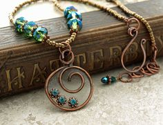 Blue green crystal resin in copper frame by DragonflyDreamers,