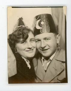 Couple in costumes paper hats with moon    photobooth  Vintage photo booth